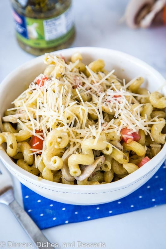 A bowl of pasta topped with cheese