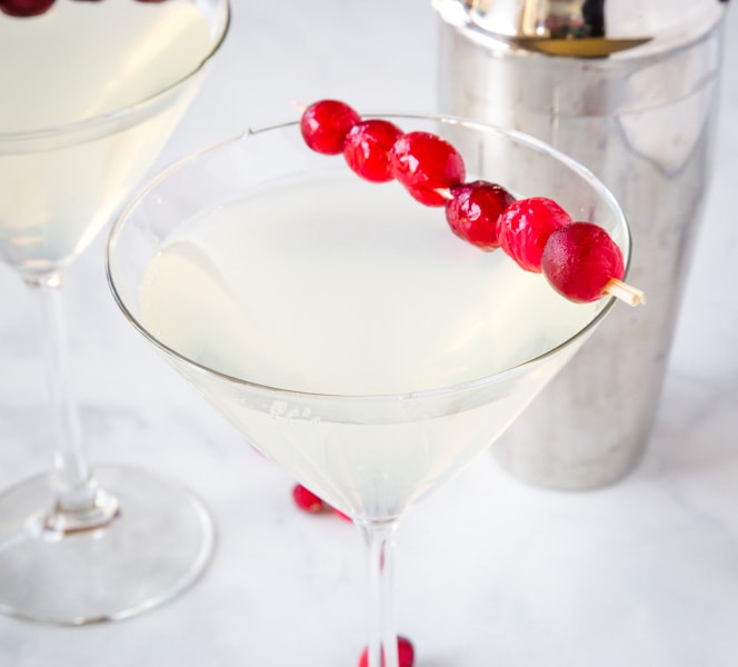Winter White Cosmo - a fun seasonal twist on the classic Cosmopolitan cocktail. Fruity, tart, slightly sweet and delicious. Great for your holiday parties!
