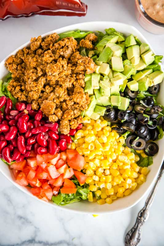 Use taco meat and Doritos to make this salad over the top good.