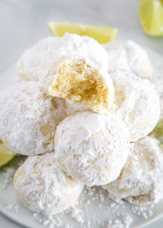 Lime Cooler Cookies - Melt in your mouth cookies flavored with lots of lime and coated in powdered sugar. They are light and fluffy and perfect all year round!