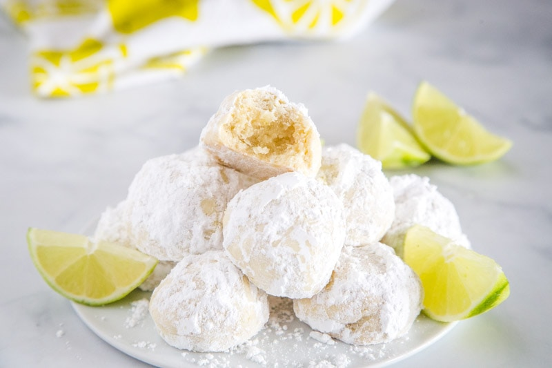 Lime Cooler Cookies - Sweet, buttery, melt in your mouth cookies flavored with lots of lime and coated in powdered sugar. They are light and fluffy and perfect all year round!