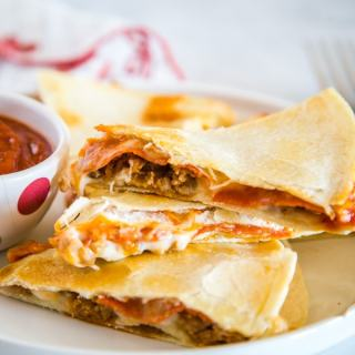 Pizza Quesadilla - Turn your favorite pizza into a quesadilla for a quick and easy dinner tonight!  Fill with pepperoni, sausage, peppers, black olives, or whatever your favorite is!