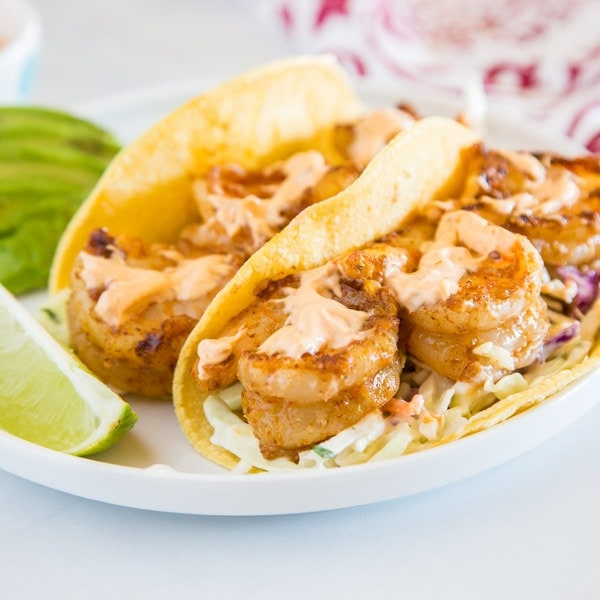 shrimp tacos on a plate, with Chipotle and Taco