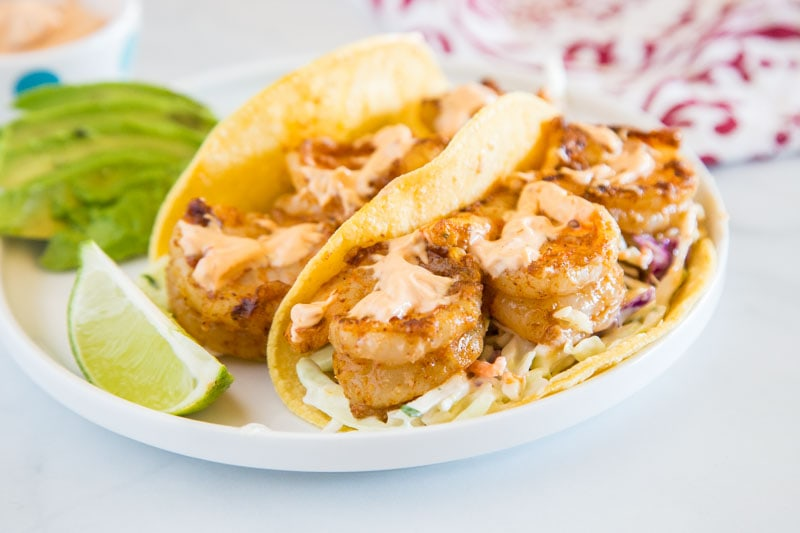 Chipotle Shrimp Tacos - An easy shrimp taco recipe with spiced shrimp, a cool lime coleslaw, and topped with creamy chipotle sauce. Packed with so much flavor and ready in minutes, so it is perfect for a weeknight dinner.