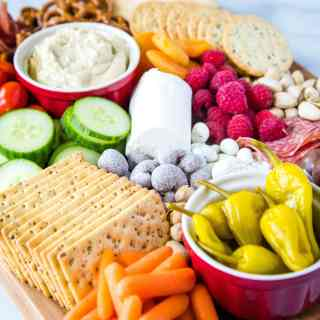 A bowl filled with different types of food, with Charcuterie and Dinner