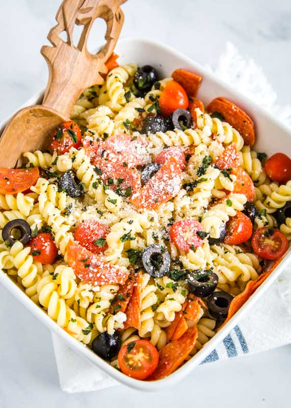 pasta salad with olives, pepperoni, tomatoes, and italian dressing