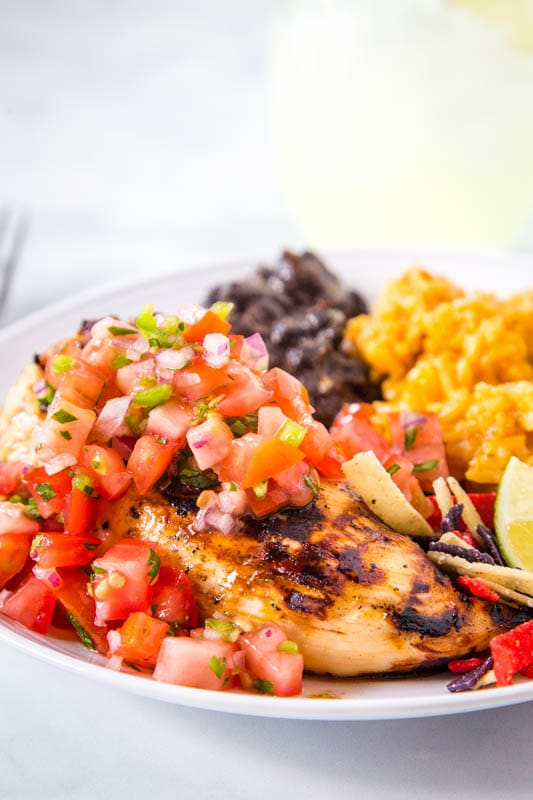 margarita chicken chilis on plate with rice and beans