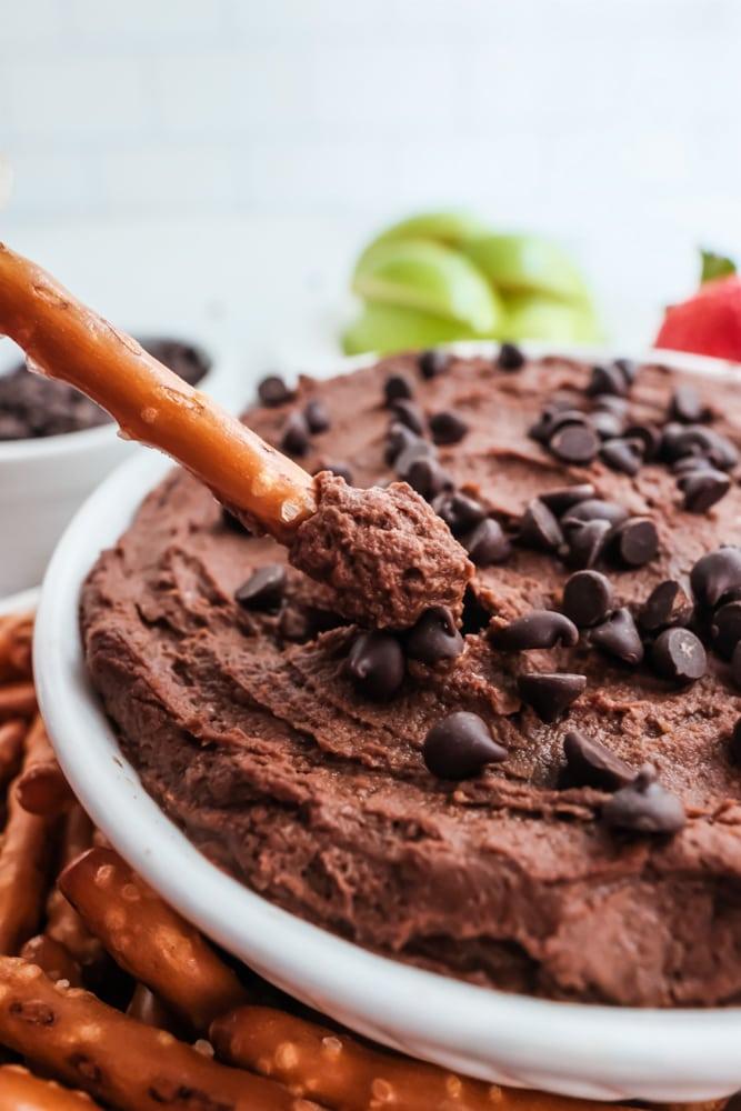 chocolate hummus in bowl with pretzel stick