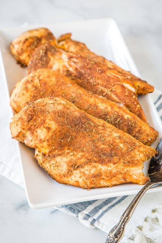 white platter of smoked chicken breasts