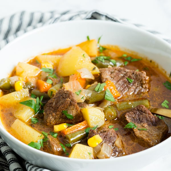 Instant Pot Vegetable Beef Soup - tender beef and vegetables in a hearty and easy to make soup that the whole family will love!