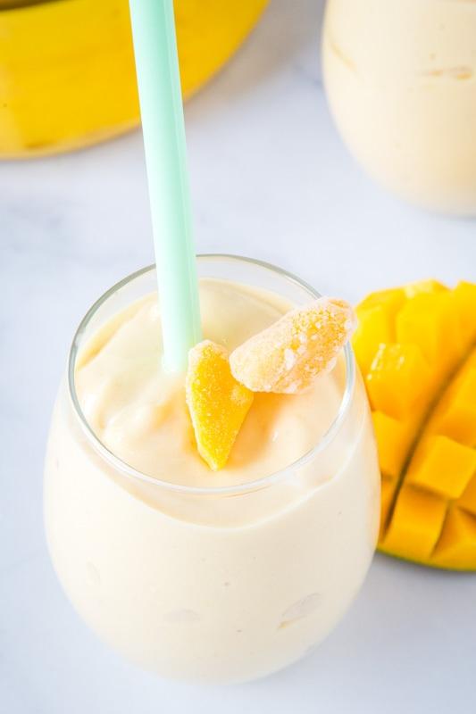 mango smoothie with chunks of mango on top
