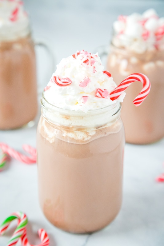 glass of peppermint hot chocolate topped with whipped cream