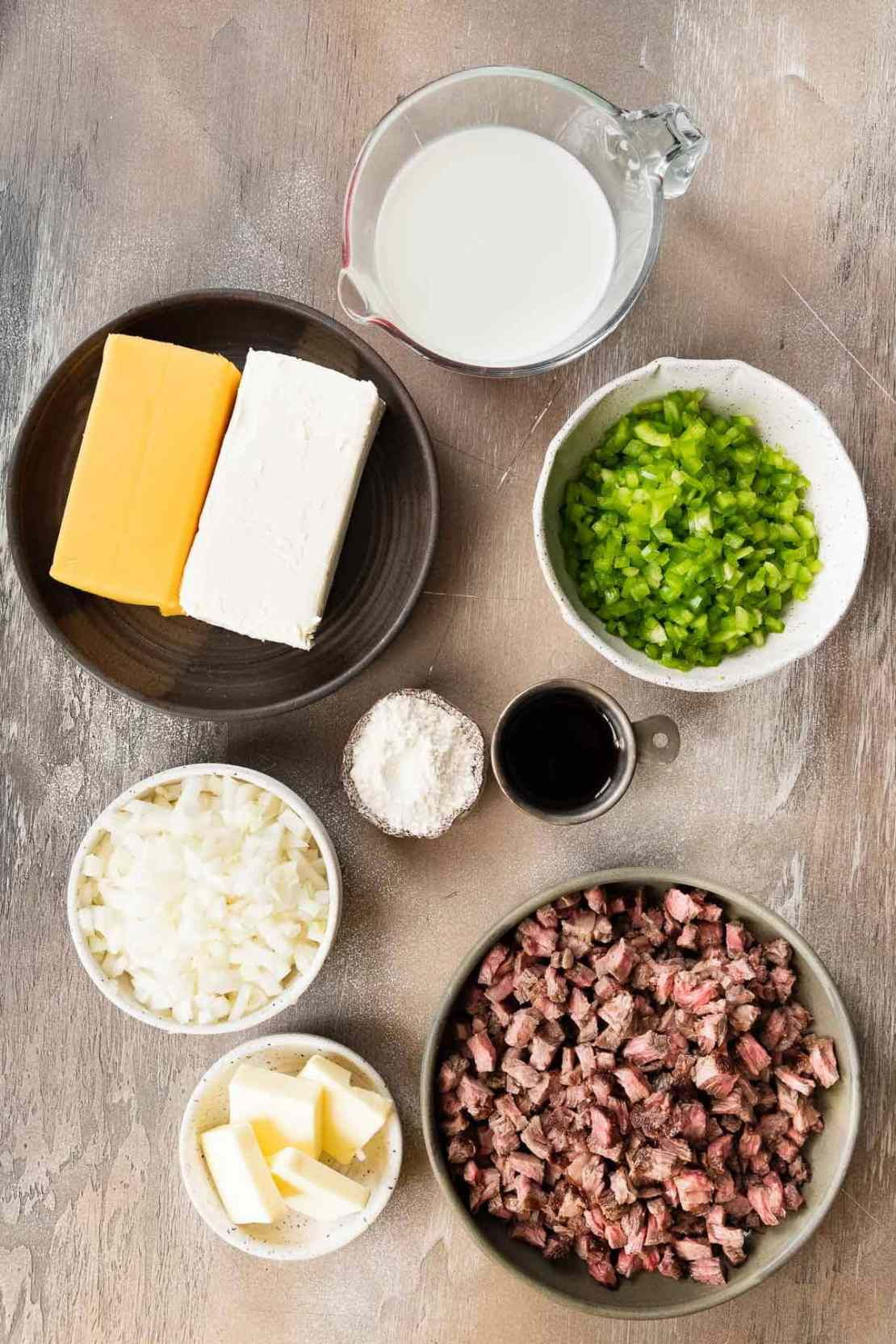 Ingredients for Philly Cheesesteak Dip in prep bowls