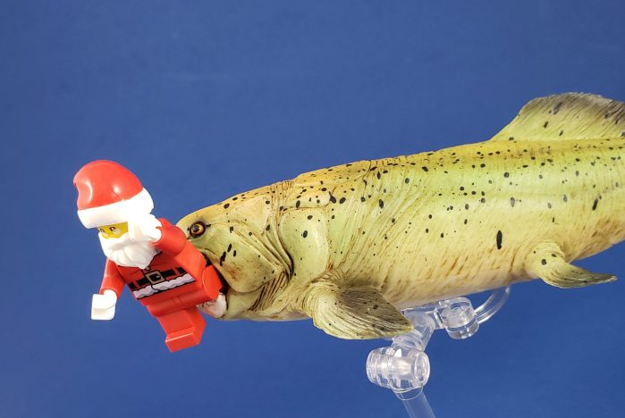 Mojo Dunkleosteus attacks Lego Santa Claus