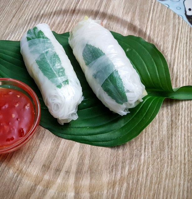 thai rolls complete with mint leaf showing through rice wrapper