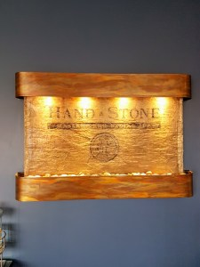 hand and stone massage sign