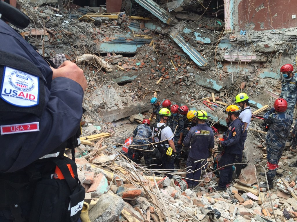 American and Nepalese teams work together to rescue 15-year-old Pemba Lema from a large pile of rubble.