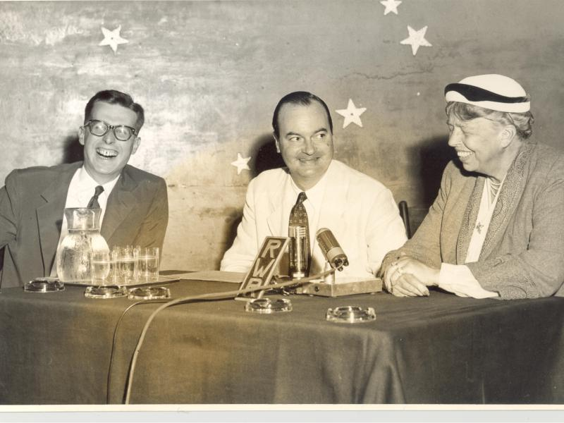 Photograph of Wolfgang J. Lehmann (far left) in Austria in the early 1950s, sitting with former first lady Eleanor Roosevelt (far right) and fellow embassy staff member B.J. McGuigan (center) for a press conference.