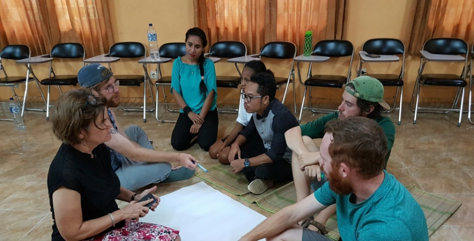 Peace Corps workers work with citizens