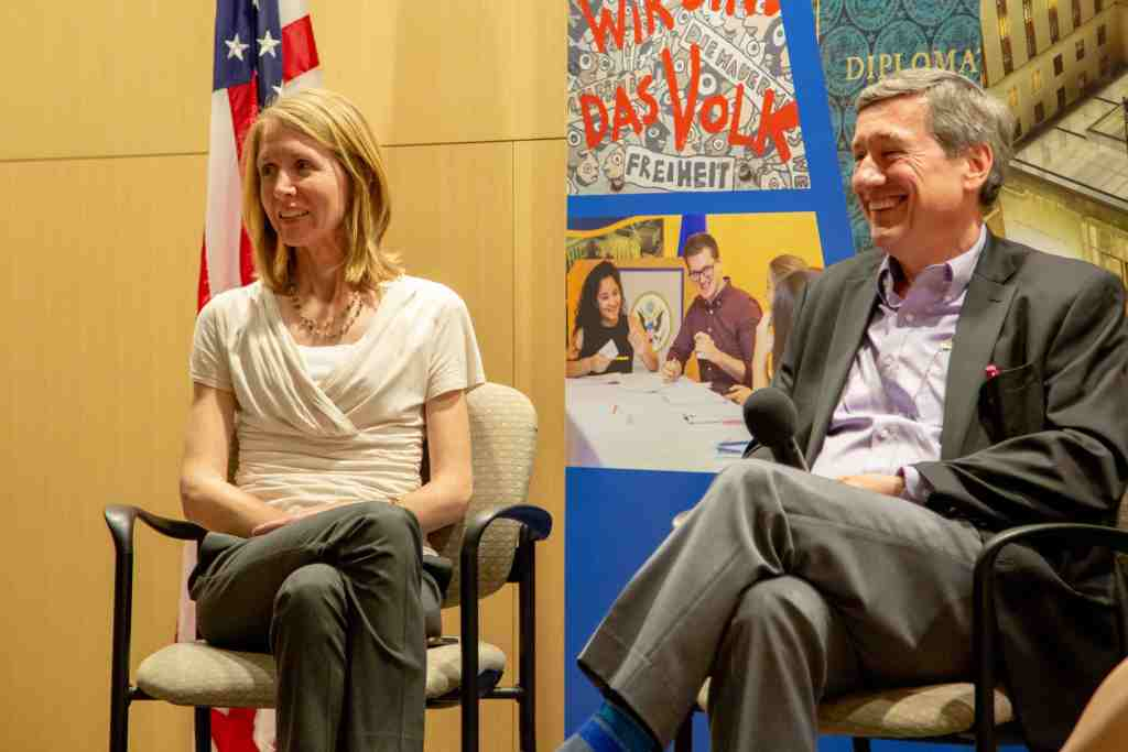 Associate Curator and Lavender Scare speaker sit on stage