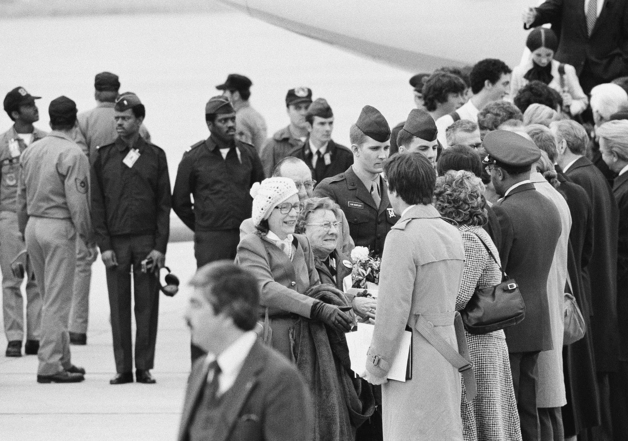 Freed hostage Kathryn Koob reaches out to shake hands with the receiving line after her arrival at Andrew Air Force Base, Md., on Tuesday, Jan. 27, 1981. She is followed by her parents, Elsie and Harold Koob of Jessup, Iowa, and former hostage Sgt. Steve Kirtley of Little Rock, Ark.