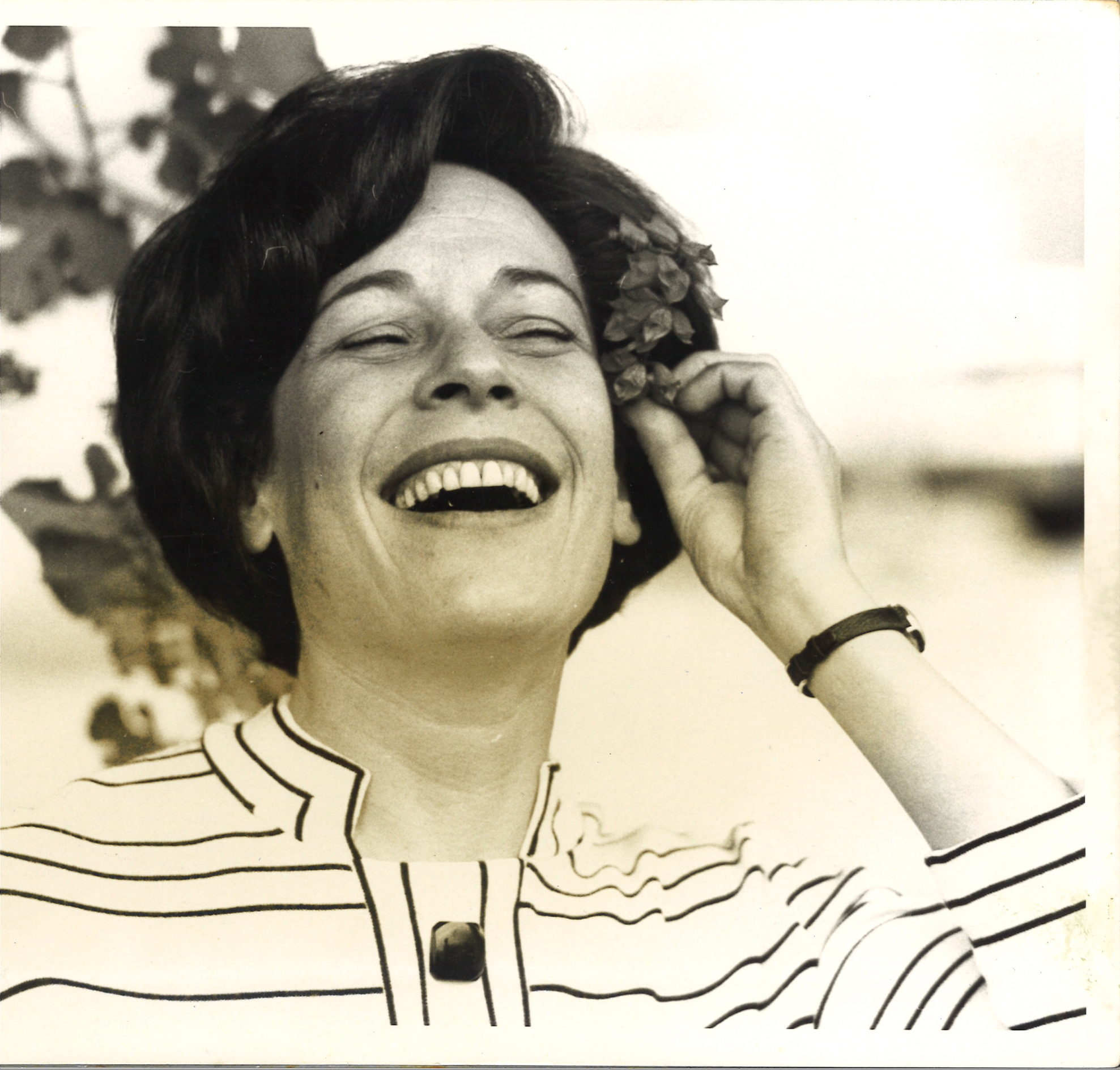 Portrait of Lois Roth with flower