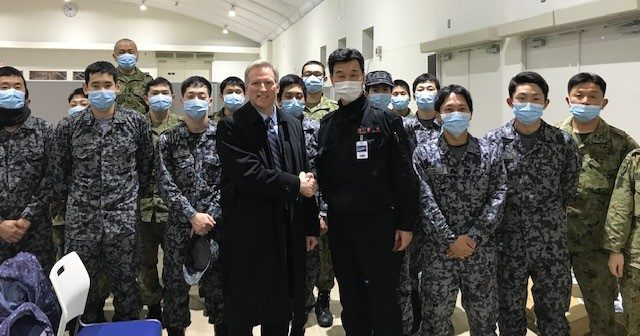 U.S. Mission to Japan Chargé d'Affaires Joe Young with the Japanese military who facilitated services to U.S. citizens on cruise ships.