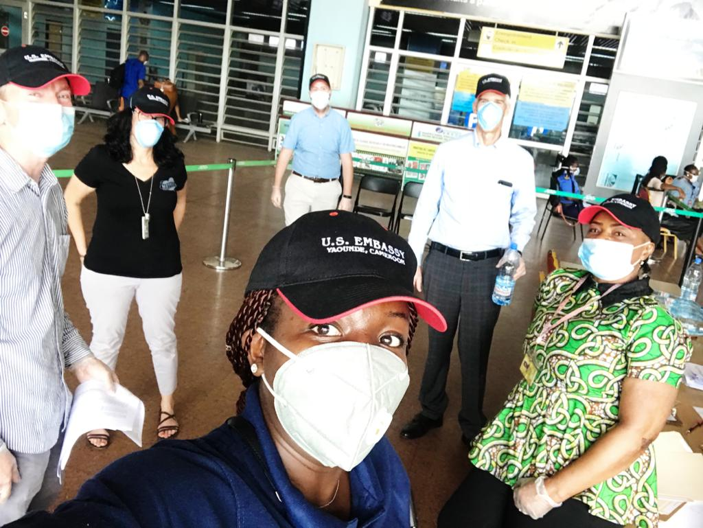 Staff from the U.S. Embassy in Yaoundé, Cameroon supporting repatriation efforts pose outside the airport in their protective masks.