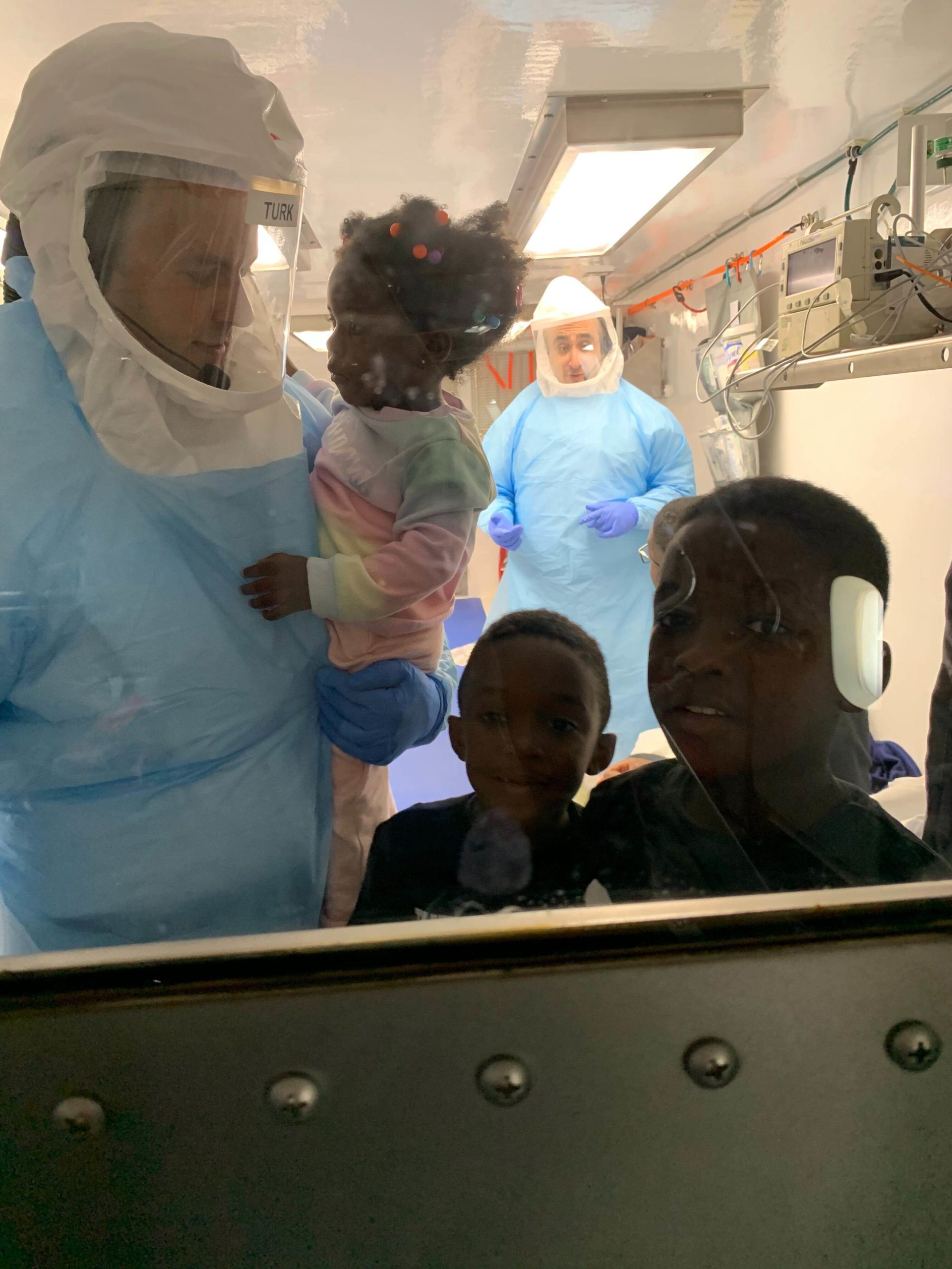 Children of the American citizen working for the World Health Organization in Brazzaville, Congo return to the United States in a Containerized Biohazard Containment System (CBCS) provided by Operational Medicine.