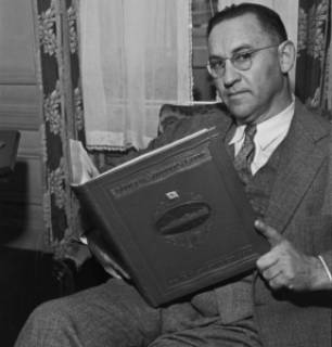 """""""Meyer Franklin Kline, pictured in September 1935 holding a copy of the guidebook that he had spent over 20 years compiling and editing."""