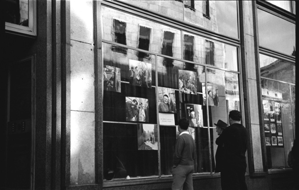 Bulgarians browse photos of American life in the windows of the U.S. Legation in Sofia, Bulgaria, in 1963.