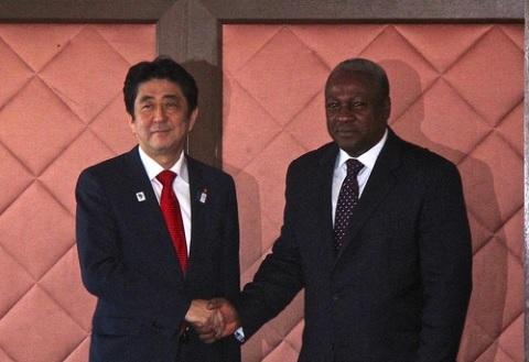 Japanese Prime Minister, Shinzo Abe in a handshake with President John Mahama