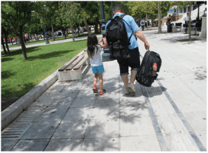 A prominent Turkish scientist who fled his native country is leaving Athens with his seven-year-old daughter, in hopes of being allowed to fly to Milan from which he'll eventually catch up with his wife and their 14-year-old daughter. He's carrying all of his worldly possessions in two backpacks. On this, their fifth attempt, they got lucky and eventually joined his wife and older daughter in Munich. (Photo: Jennifer Campbell)