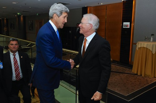 U.S. Secretary of State John Kerry shakes hands with U.S. Ambassador to the United Nations Vienna Office Joe Macmanus - who is the State Department's incoming Executive Secretary - before addressing staffers from the three Department missions in Vienna, Austria, during a break in the Iran nuclear talks on July 14, 2014.
