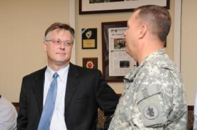 Matthew T. Harrington (left), Army South's political advisor, speaks with Col. Steven Woods, Army South deputy commander for support, Aug. 24, 2011 (DOD photo)