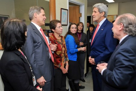 U.S. Secretary of State John Kerry speaks with U.S. Ambassador to Yemen Matthew Tueller