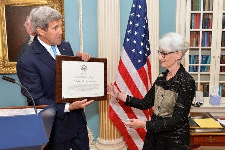 U.S. Secretary of State John Kerry presents a Distinguished Service Award to Under Secretary for Political Affairs Wendy Sherman during a farewell ceremony in her honor at the U.S. Department of State in Washington, D.C., on September 21, 2015. [State Department photo/ Public Domain]