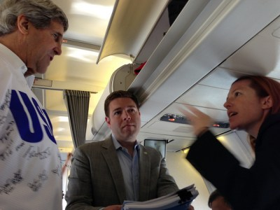 U.S. Secretary of State John Kerry speaks with his chief of staff, David Wade, and State Department Spokesperson Jennifer Psaki before his airplane departs Moscow, Russia, on May 8, 2013. [State Department photo/ Public Domain]