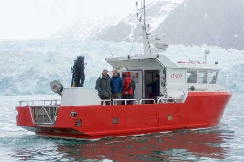 "The research vessel ""Teisten,"" carrying U.S. Secretary of State John Kerry and Norwegian Foreign Minister Borge Brende, floats on the Kongsfjorden in Ny-Alesund, Norway, the northernmost civilian settlement in the world, as the two leaders inspect the Blomstrand Glacier to see the effects of global warming on the Arctic environment on June 16, 2016. [State Department photo/ Public Domain]"