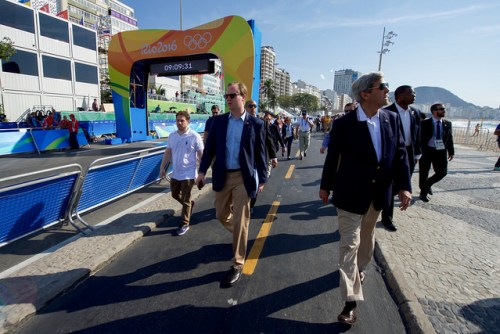 Secretary Kerry and Staff Tour the Men's Olympic Cycling Area Before The Start of a Race U.S. Secretary of State John Kerry and State Department Senior Aide Jason Meininger walk along the Copacobana beach in Rio de Janiero, Brazil, as the Secretary and his fellow members of the U.S. Presidential Delegation tour the men's Olympic cycling area before the start of a race on August 6, 2016. [State Department Photo/Public Domain]