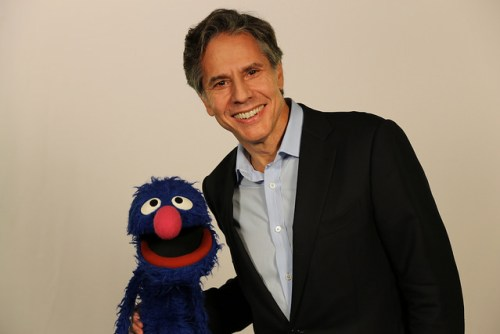 "Deputy Secretary of State Antony Blinken meets with Sesame Street's ""Grover"" to talk about refugees at the United Nations in New York City, New York on September 19, 2016. [State Department Photo/Public Domain]"