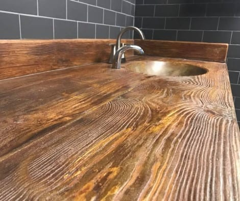 Stamped concrete countertop stained to look like wood