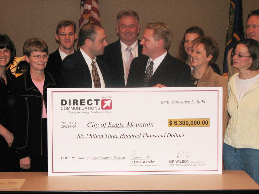 At a signing ceremony with the city council and mayor present, Direct Communications presented the City of Eagle Mountain a check for $6.3 million for the purchase of the former Eagle Mountain Telecom network.