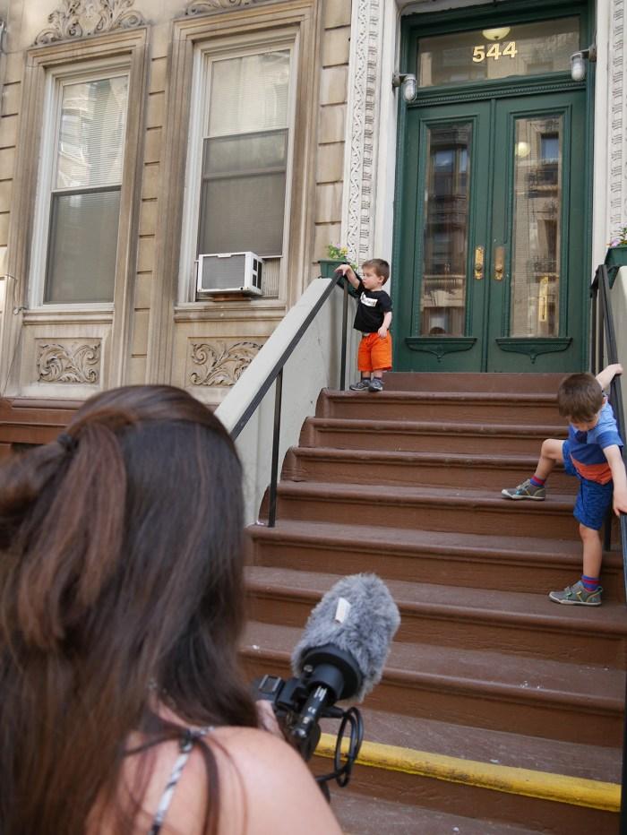Alexandra Hidalgo filming her children