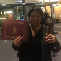 Holding Spirit Award from Reel Sisters Film and Lecture Series at Time Warner building.