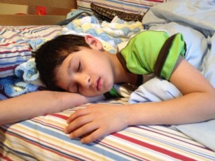 Photo of a young boy, sleeping.