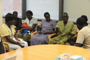 Ugandan family members in a conference room