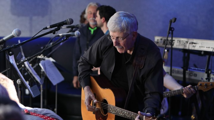 Francis Collins plays guitar with his band ARRA