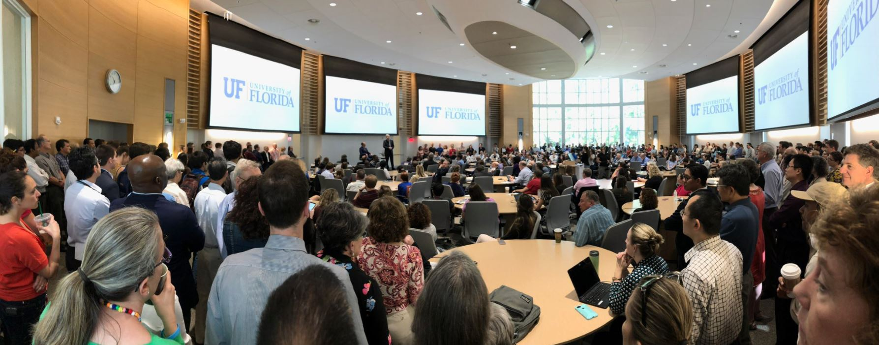 Francis Collins addresses a packed conference hall at the University of Florida