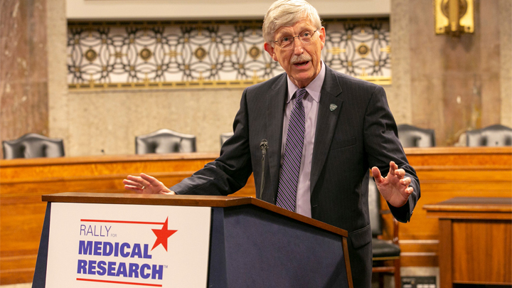 Francis Collins speaking from podium